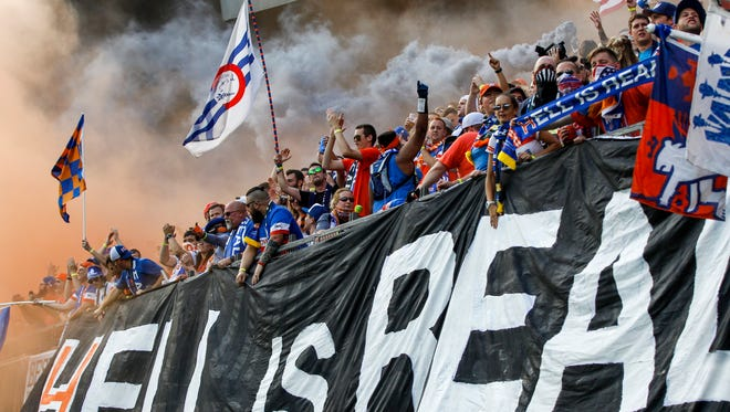 FC Cincinnati fans in the Bailey let off smoke bombs at the start of the game against team Columbus Crew in the US Open Cup Tuesday, June 13, 2017 at Nippert Stadium.