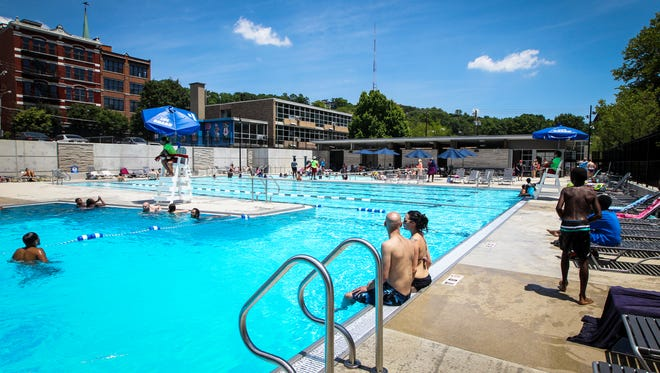 Adults and children beat the heat at the new Ziegler pool  Friday, June 16, 2017 in Over-the-Rhine. The pool opened to the public June 10, 2017.
