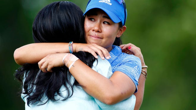 Westlake High graduate Danielle Kang embraces her mom as she celebrates winning the Women's PGA Championship on Sunday.
