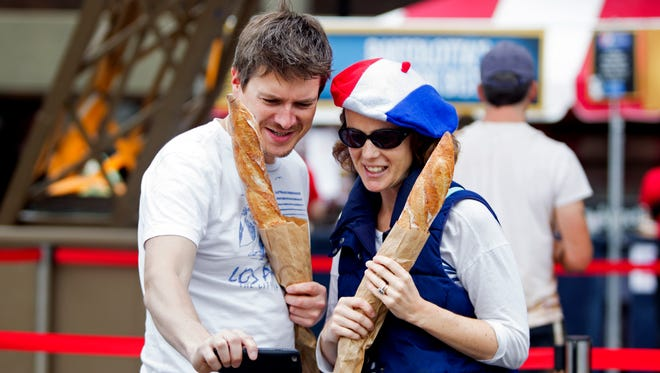 Sylvia Adams (left) and Natalie Clement (right) do the whole French thing, with baguettes and berets, at Milwaukee's Bastille Days in 2016.