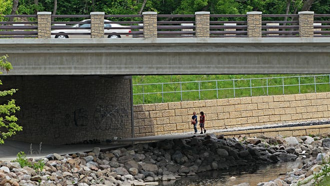The Kinnickinnic River at S. 6th St. flows through a rock-lined channel. MMSD is planning to install a mechanical aerator into the river downstream of I-94 to boost oxygen levels for fish to breathe.