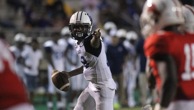 Gadsden County quarterback Dentarrius Yon points as he scampers in for a two-point conversion following his own touchdown run. Yon ran for two touchdowns and threw for one in a 22-16 win over Leon.