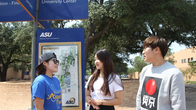 From left to right, Yujung Nam, 22, Yoojung Jin, 22, and Byeongchan Jeong, 20, discuss their thoughts about North Korea.