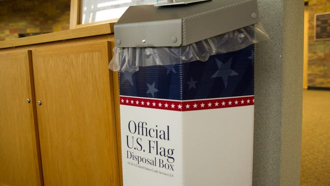 A flag disposal receptacle is located inside the San Juan County administration office building Thursday in Aztec. San Juan County is providing places for people to drop off their old flags for retirement.
