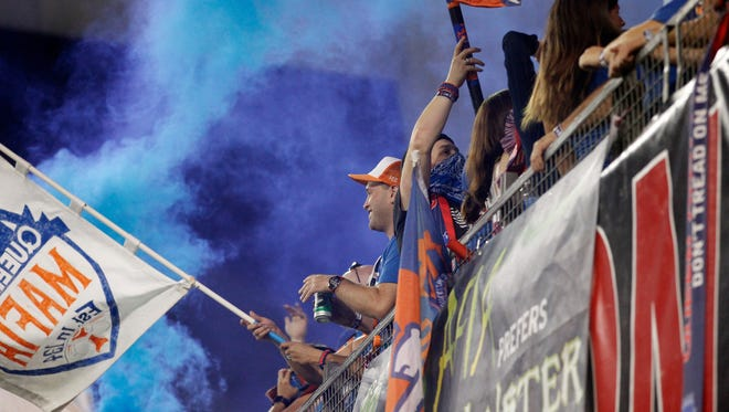 Fans celebrate a goal in the second half during the USL soccer match between the New York Red Bulls II and FC Cincinnati, Saturday, Sept. 16, 2017, at Nippert Stadium in Cincinnati. FC Cincinnati won 4-2.