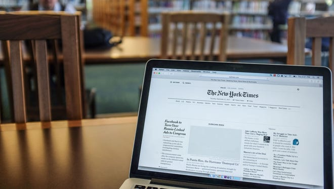 The New York Times web page loading at the Rancho Mirage Public Library on Thursday, September 21, 2017 in Rancho Mirage.