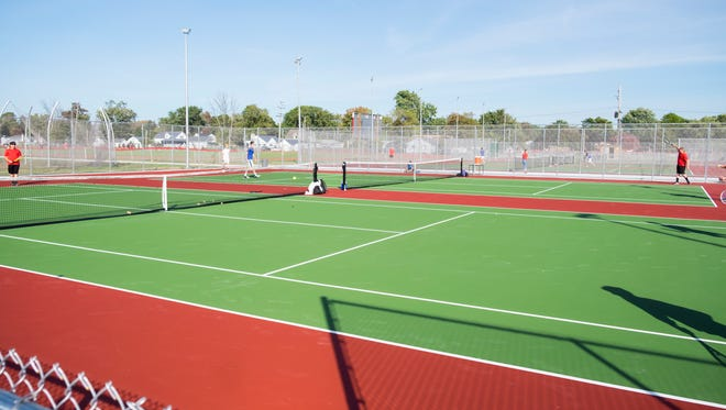 Tennis players from Port Huron High School compete against players from L'anse Creuse High School on the new tennis courts at Port Huron High School Oct. 3.