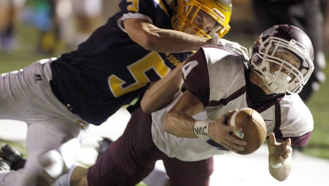 Brandon Clark, right, and Okemos need a win to automatically qualify for the playoffs.