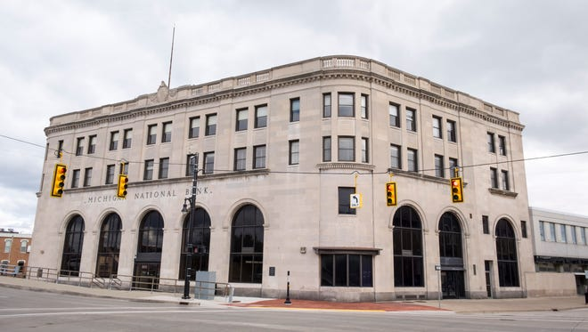 The Michigan National Bank building on the corner of Military and Water streets will be converted into the new CityFlats Boutique Hotel.