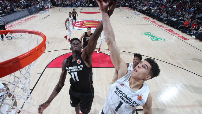 McDonalds All-American West forward Michael Porter Jr. (1) battles for a rebound against East center Mohamed Bamba (11) during the 40th Annual McDonald's High School All-American Game at the United Center.