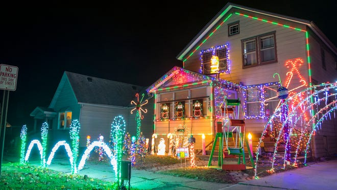 Each year, Derek Harper decorates his house at 520 Main St. in Marine City with thousands of Christmas lights. In addition to a normal light display, the lights can flash along to pre-programmed songs that are played over a radio station.