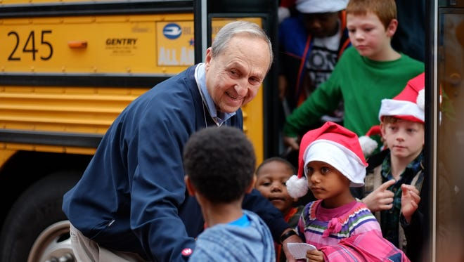 Bill Weigel greets children as they arrive to the Weigel's Family Christmas at Kmart on Saturday, December 2, 2017 in Halls. Weigel's celebrates its 20th year of teaming with the Salvation Army to bring joy and dreams to underprivileged children from Knoxville and the surrounding areas. The children range in age from 5 years old to 9 years old and are each given $150 for a Christmas shopping spree at the Hall's Kmart store on Maynardville Pike. (Shawn Millsaps/Special to News Sentinel)