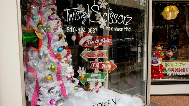 The storefront at Twisted Scissorz decorated for the Window Wonder Land competition. The competition; organized by the North vs. South cross-town charity challenge; encourages local businesses to decorate their storefronts.