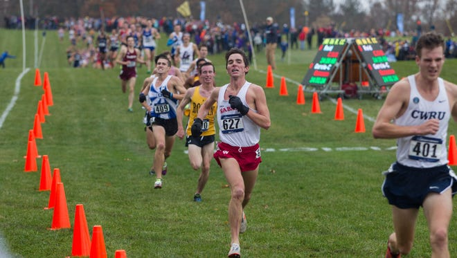 Wabash College junior Dominic Patacsil, second from right, achieved his three-year goal of earning NCAA Division III All-America honors recently with a 12th-place finish at the NCAA Championships.