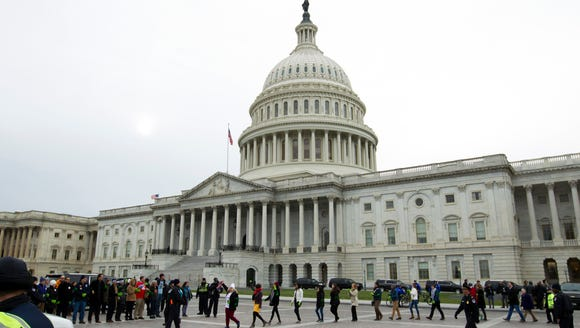 Demonstrators are arrested outside of the U.S. Capitol