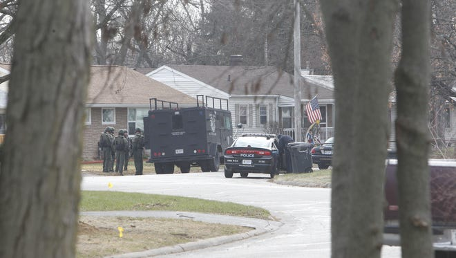 Lafayette police SWAT members stand down in the 2400 block of Crestview Court Thursday morning after a standoff. No one was injured, and the man holed up inside a house here surrendered.
