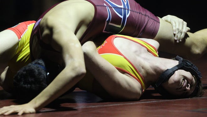 La Quinta High School's Marcus McAvoy gets on top of Palm Desert High School's Vinnie Jardino in the 120 pound boys weight class at La Quinta High School on January 10, 2018.