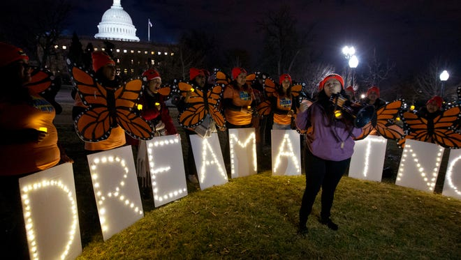 Demonstrators chant in support of protections for DREAMers during a rally outside the Capitol, Sunday, Jan. 21, 2018, in Washington.