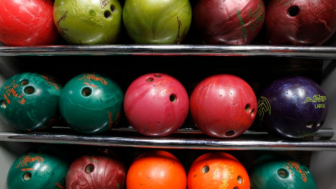BowlingShoes, biz, adp, 6 of 9 -  Bowling balls are seen on Thursday, March 8, 2018 at  Bowlero in Wauwatosa. The humble bowling shoe is getting a makeover. In a national design contest, called ÒBebowled,Ó bowlers are being asked to come up with a fresh, contemporary look for their shoes. The five finalists will have their footwear shown off in a Times Square runway show. The winner, to be chosen by a celebrity fashion judge, will have their design replicated at bowling alleys across the country. The contest is being sponsored by the national chain, Bowlero, which has a bowling center in Wauwatosa. Angela Peterson/Milwaukee Journal Sentinel