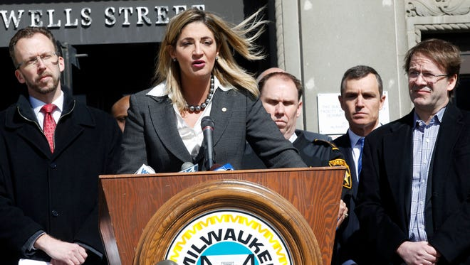 Milwaukee County Corporation Counsel Margaret Daun announces a federal lawsuit against pharmaceutical companies and distributors suspected of contributing to the local opioid epidemic. Daun was joined at the County courthouse by Milwaukee County Board Chairman Theodore Lipscomb, Sr. , left, Milwaukee County Undersheriff Tobie Weberg, to the right of Daun, and Milwaukee County Executive Chris Abele, far right.