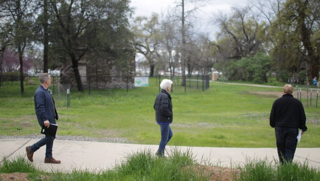 Jason Schroeder, left, a member of Redding's Community Services Advisory Commission, Vice Mayor Francie Sullivan and Redding project manager Terry Hanson walk through the Parkview Riverfront Park on Wednesday during a tour of more than a half-dozen city parks.