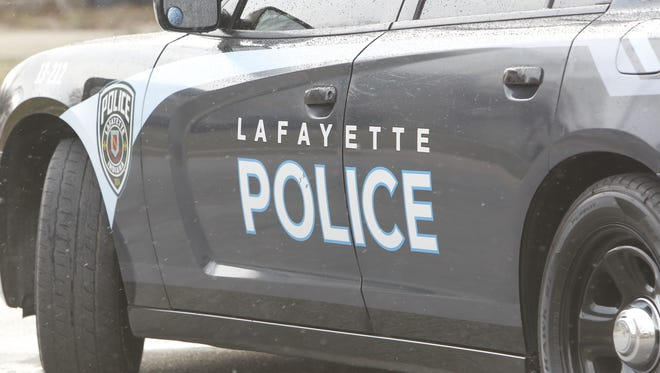 Lafayette police arrived at an armed robbery scene to find the accused robber being held down in the parking lot by a customer and an employee, according to police.