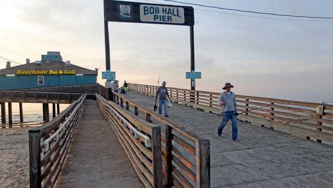Bob Hall PIer within Padre Balli Park rents fishing rods.
