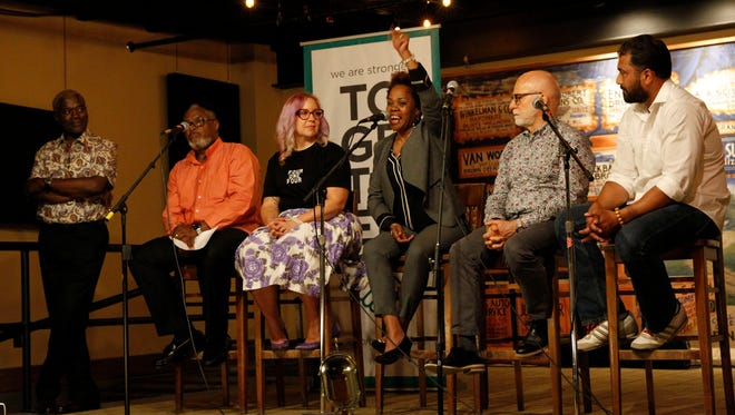 """(From left) Andre Lee Ellis,  Earl Ingram Jr., Nicole """"Darlin Nikki"""" Janzen, Tina Nixon, Gary Hollander and Pardeep Singh Kaleka appear at the Anodyne Cafe in Walker's Point for a Journal Sentinel storytellers event focused on racism in Milwaukee."""