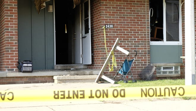 A 43-year-old woman and her 5-year-old son were killed Thursday, June 7, 2018, in a fire at the LaRoy Froh public housing complex in Lansing.