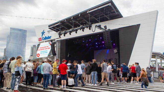 Fest-goers mingle at the new U.S. Cellular Connection Stage on the Summerfest grounds before a stage-warming concert featuring Diplo on Friday.