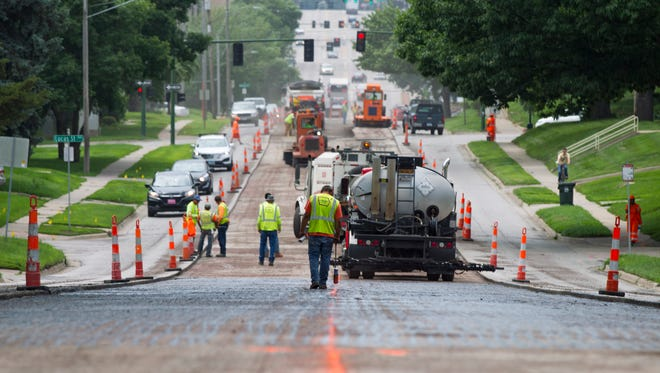 L.L. Pelling road crews work along Burlington Street between Van Buren and Summit Streets on a resurfacing project on Monday, June 25, 2018. The construction is part of recurring and annual maintenance.