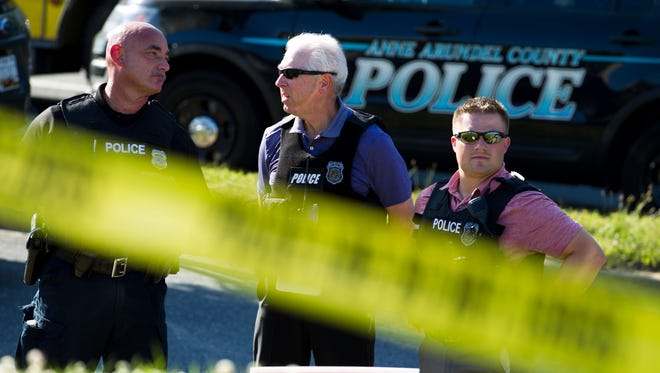 Police officers secure the area after multiple people were shot at an office building housing The Capital Gazette newspaper in Annapolis, Md. on June 28, 2018.