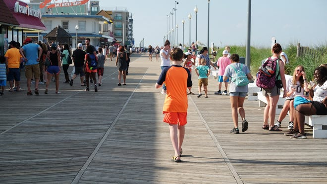 People walk down the Rehoboth Boardwalk on Thursday, June 28, 2018.