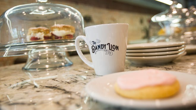 A Dandy Lion coffee cup is seen on Tuesday, July 3, 2018. Dandy Lion is now open and will be expanding their hours after pedestrian mall construction is completed.