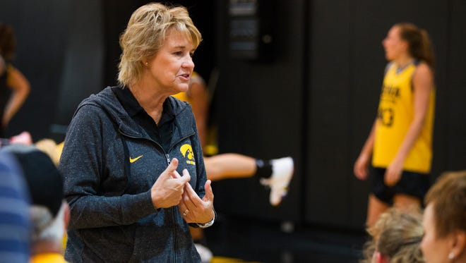 Iowa head coach Lisa Bluder talks with fans during a women's basketball summer scrimmage on Friday, July 13, 2018, at Carver-Hawkeye Arena in Iowa City, Iowa.