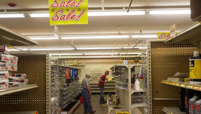 Customers shop inside Paul's on Saturday, July 14, 2018, in Iowa City, Iowa. The family owned discount store closed it's Iowa City location on July 14.