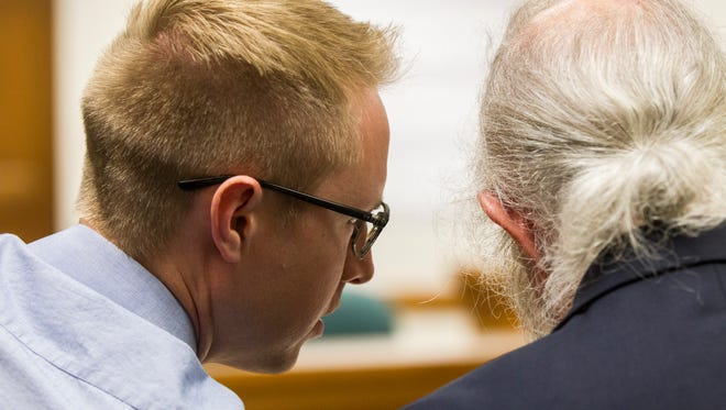 Benjamin Craig Tweedt talks with Defense Attorney Phil Mears during Tweedt's sentencing hearing on Monday, July 16, 2018, at the Johnson County Courthouse in Iowa City, Iowa.