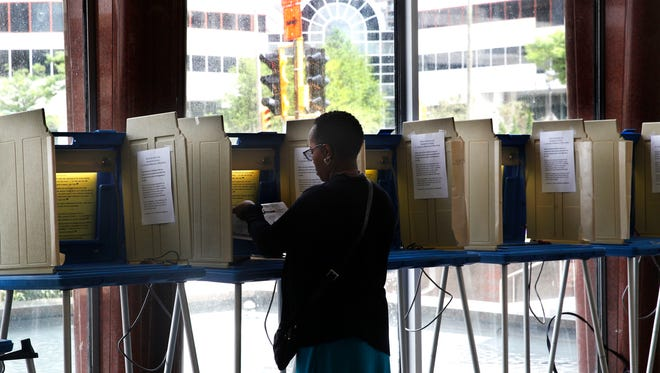 Kimberly Berry participates in early voting on Aug. 2 at the Zeidler Muncipal Building at 841 N. Broadway in Milwaukee.