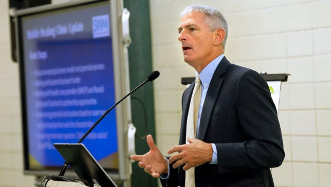 Marquette University President Mike Lovell hosts a recent brainstorming session to tackle the epidemic of trauma that ravages the city of Milwaukee. His group, called Scaling Wellness in Milwaukee, or SWIM, hosts a major conference on trauma this week.