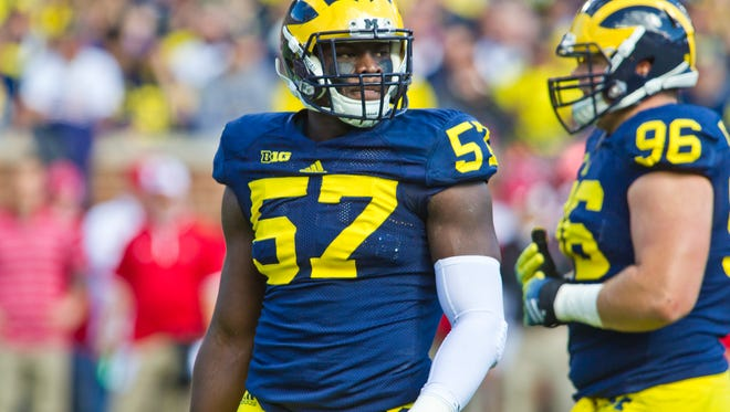Michigan defensive end Frank Clark (57) in the first quarter of an NCAA college football game against Miami (Ohio) in Ann Arbor, Mich., Saturday, Sept. 13, 2014.