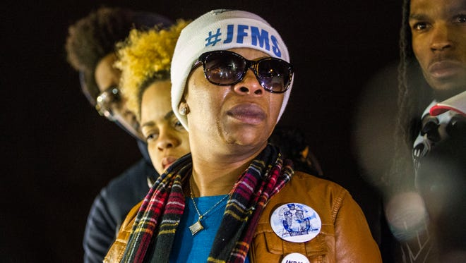 Lesley McSpadden, center, cries outside Ferguson Police Station after the grand jury decided not to indict Officer Darren Wilson in the shooting of Michael Brown on Aug. 9.