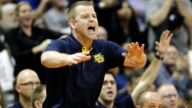 Marquette head coach Steve Wojciechowski reacts against the Georgia Tech Yellow Jackets during the first half at HP Field House .