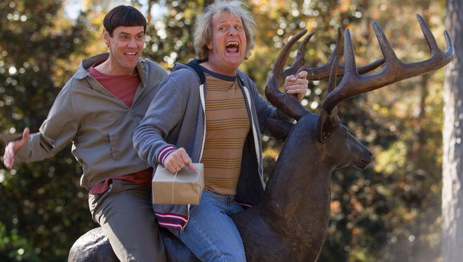"""Hopper Stone,  AP This image released by Universal Pictures shows Jim Carrey, left, and Jeff Daniels in a scene from """"Dumb and Dumber To."""" (AP Photo/Universal Pictures, Hopper Stone) ORG XMIT: NYET150"""