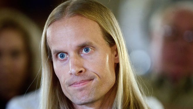 File--In this May 13, 2014, file photo  Conrad Engweiler, 40, appears before the state parole board in Salem, Ore.  Engweiler,  who served 24 years for raping and killing a high school classmate, was released Thursday, Oct. 16, 2014,  after years of hearings and appeals. (AP Photo/The Oregonian, Benjamin Brink, file)