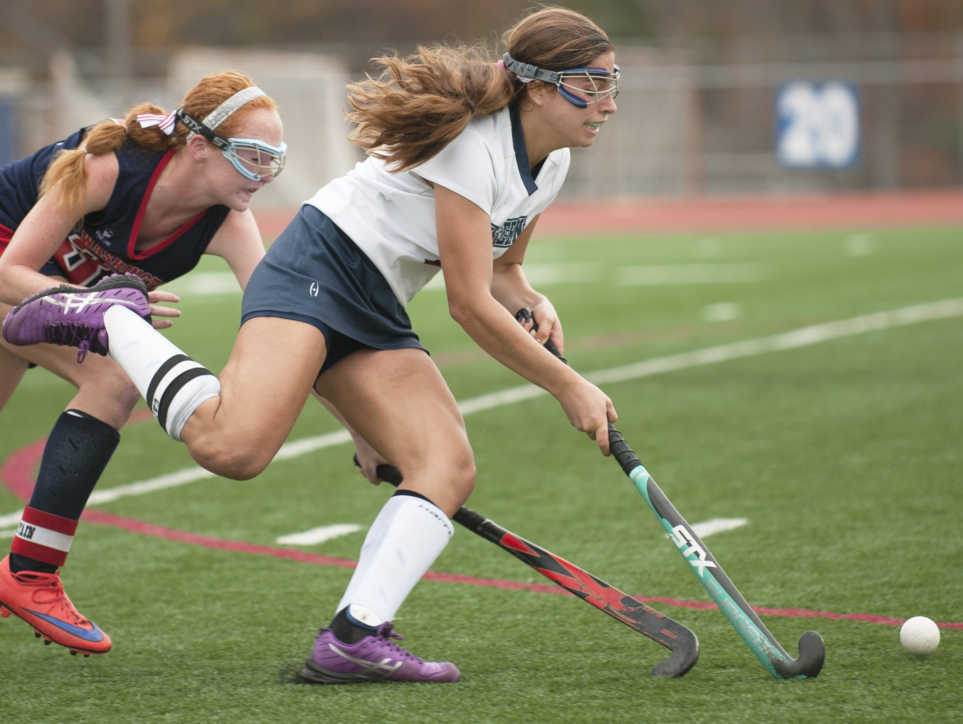 Eastern's Madison Morano controls the ball in front of Washington Township's Colleen McAninley during the second half of the South Jersey Group 4 field hockey final Thursday at Eastern High School.