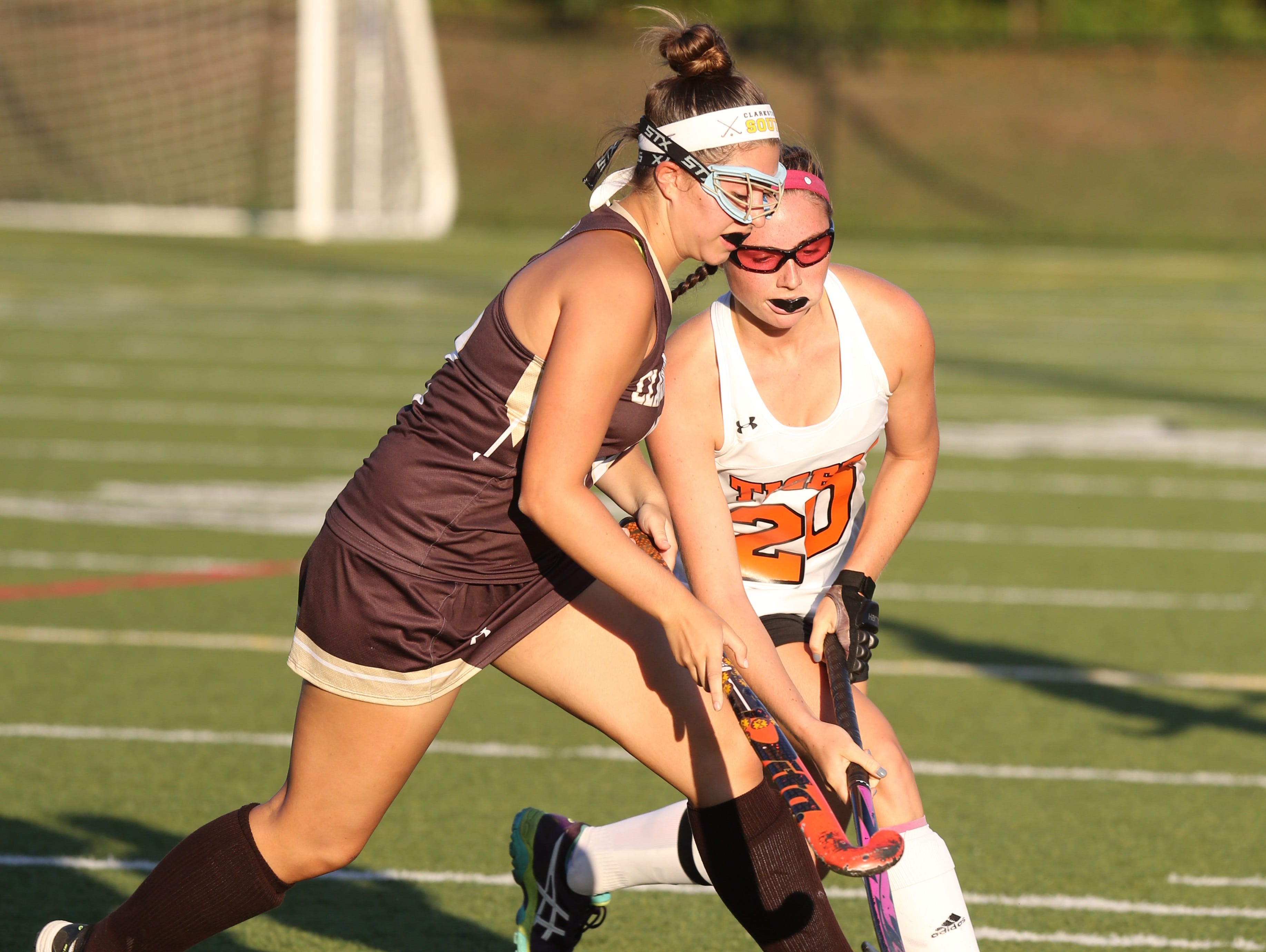 Clarkstown's Danielle Noia (12) and Mamaroneck's Sophie Miller (20) battle for control of the ball during girls field hockey game at Mamaroneck High School on Sept. 27, 2016.
