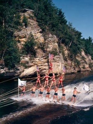 Water skiers form a pyramid for the Tommy Bartlett Show in the Wisconsin Dells in this undated photo. The 69-year-old show's operator said Wednesday that it is closing permanently because of business losses caused by the coronavirus pandemic.