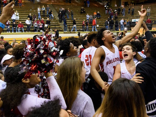 Surrounded by a sea of fans, the Bosse Bulldogs celebrate
