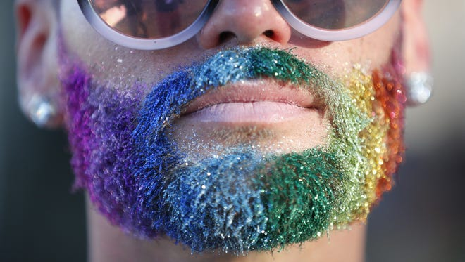 Daniel Rodriguez shows off his Pride flag beard during the Phoenix Pride Festival at Steele Indian School Park in Phoenix on April 7, 2018.