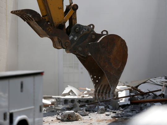 Demolition crews started razing buildings along the west side of North Boonville Street on Monday, June 18, 2018 to make room for expansion of the Greene County Jail.